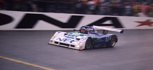 Chris Ronson crosses the line in the Mazda Kuzu DLY, Daytona 1999, Copyright Mike Fuller 1999