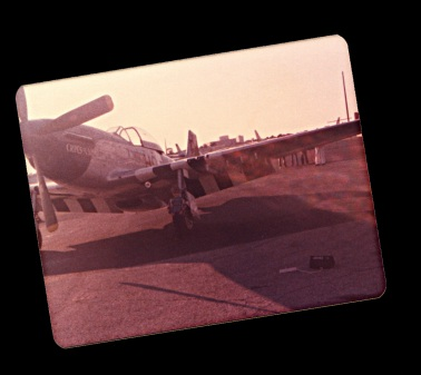 Me standing near left front landing gear of Cripes All Mighty III P-51D Mustang, Herdon Field, Orlando, Florida,1979
